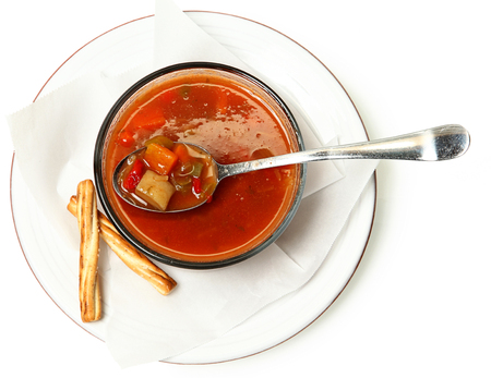 canned meat: Maryland Crab Vegetable Soup in bowl with spoon and bread sticks. Stock Photo
