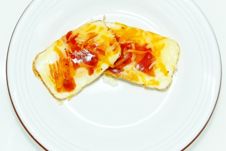 Eggs Baked in Muffin Tin with Salsa and Cheese in Plate