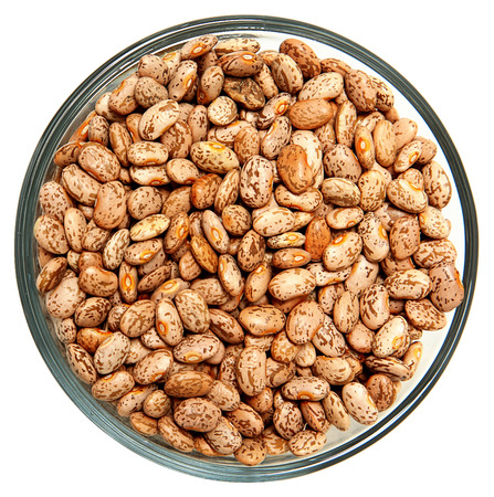 pinto: Pinto Beans Raw Unwashed in Glass Bowl Over White