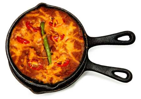Skillet Refried Beans with Hot Peppers, Cherry Tomatos and Cheddar Cheese over white