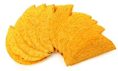 Stack of Cruncy Cornmeal gluten Free Taco Shells over white
