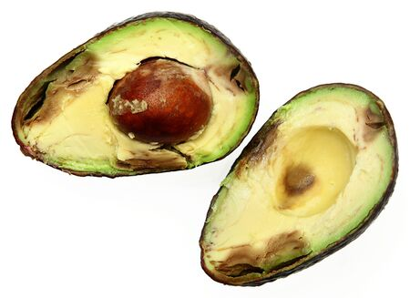 overly: Overly Ripe Spotted Avocado Sliced with Seed Over White