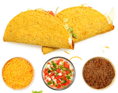 Two Tacos Stacked on White Background with cheese and lettuce. Bowl of cheese, trinity  and meat below. Imagens