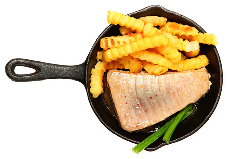 tunafish: Oven Baked Sashimi Tuna with Fries and Green Onion in Cast Iron Skillet Over White.