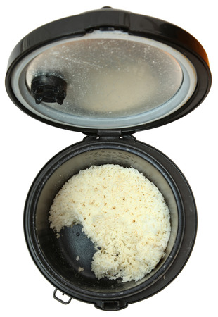 Top View Used Rice Cooker with White Rice, Over White Imagens