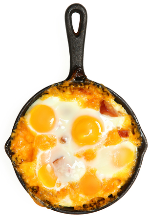 Fresh Oven Baked Eggs with Sausage and Cheddar Cheese over White Standard-Bild