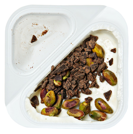 Peach Flavored Greek Yogurt with Pstachio and Chocolate Sprinkles Over White.