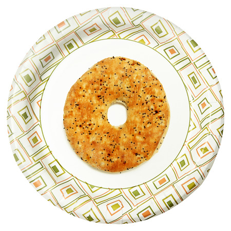 Everything Flat Bagel on Paper Plate Over White Background Imagens