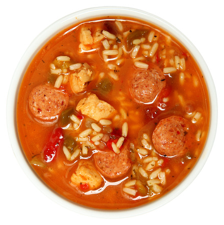 Bowl of Cajun Spicy Chicken and Sausage Gumbo Soup Over White Imagens
