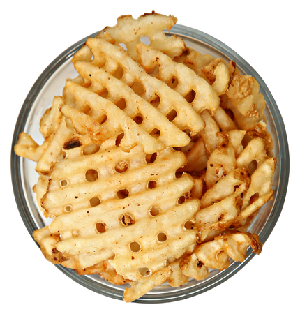 Bowl of Waffle Fries Over White High Angle View