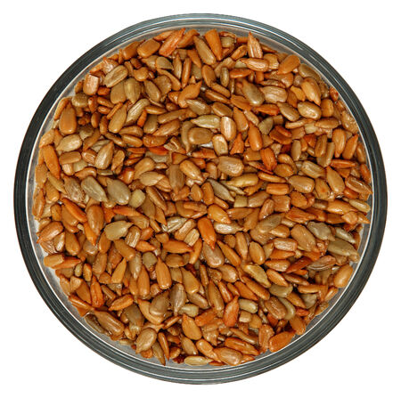 Roasted Salted Sunflower Seeds in Bowl High Angle View Over White