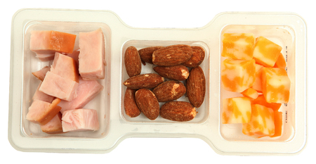 protien: Three piece protien snack pack with salted almonds, smoked turkey and marble cheddar cheese. Stock Photo
