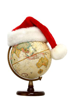 Santa hat on a globe with Australia, China and India facing out.  Isolated on white. Editorial