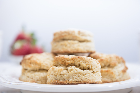 Traditional homemade british scones on white wooden table. Horizontal. Copy space.