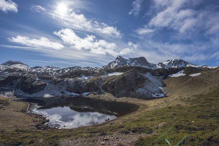 Laguna de Almagrera o Laguna de la Mina at the end of winter. Saliencia lakes in the Somiedo Nature Park, Asturias, Spain. Snowy areas in the mountains.