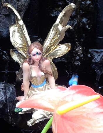 golden fairy in a fountain Stock fotó
