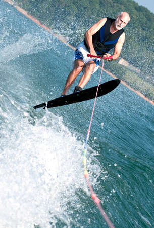 water skiing: Senior wake jumping