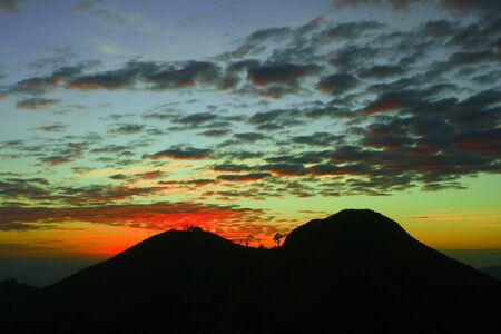 Mountain silhouette with sunset sky background Stock Photo - 15352246