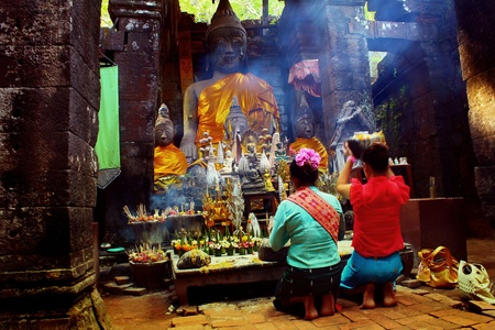 venerate: Adoration of Laotians in Buddhist temple of Wat Phu, Laos Stock Photo