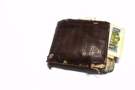 spendthrift: Old brown Wallet with Lao Currency Money
