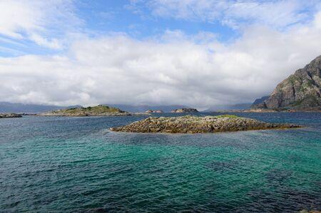 Clear Blue green waters near Hennigsvear, Lofoten, Norway. Stock Photo