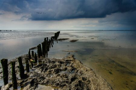 The coastal area of Northern Friesland consist of Mudflats, known as it Noarderleech, seen here during a storm. Stock Photo