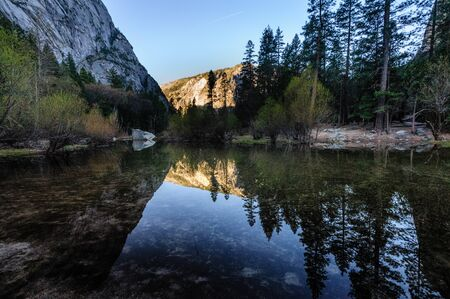 sierra: Early moring reflections of the Mountains in Mirror Lake, Yosemite National Park. Stock Photo