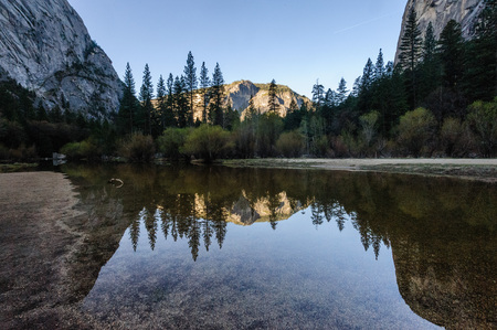 Early moring reflections of the Mountains in Mirror Lake, Yosemite National Park. Stock Photo