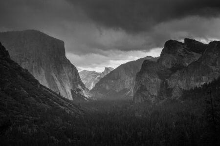 half dome: A snow storm approaching Yosemite Valley. Yosemite National Park, California, USA.