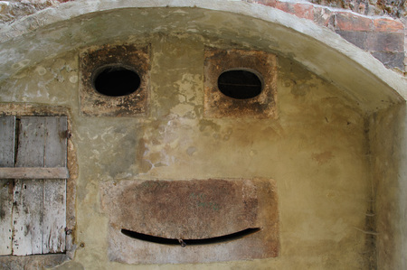 This wall in an old town in Tuscany, Italy, illustrates the phenomenong of Pareidolia, or seeing faces in things. Stok Fotoğraf
