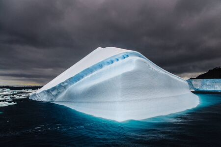 tip of iceberg: Iceberg floating off the Coast of Brown Bluff, on the tip of the Antarctic Peninsula Stock Photo