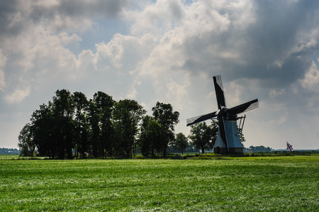 Windmill in the Dutch Province of Friesland in the early fall. Stock Photo