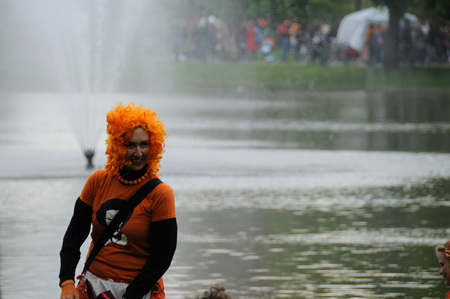 whig: AMSTERDAM, NETHERLANDS - APRIL 30. Man with an orange whig Celebrating Queensday in Amsterdam. Queensday is a popular annual festival celebrating the Queens Birthday. Editorial