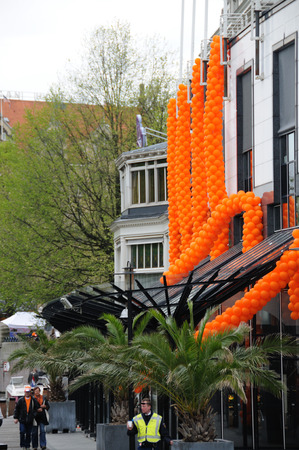 AMSTERDAM, NETHERLANDS - APRIL 30. Decorations for Queensday in Amsterdam. Queensday is a popular annual festival celebrating the Queens Birthday.