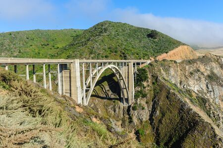 Bixby canyon bridge in the united states highway 1 along the stock bixby canyon bridge in the united states highway 1 along the californian pacific coast in mid publicscrutiny Image collections