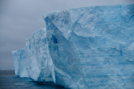 A large tabular iceberg floating in the southern atlantic ocean, near Antarctica. Stock Photo