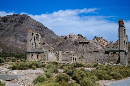 Ruins of the old Ghost town of Rhyolite, Nevada, on an early August morning. Stock Photo