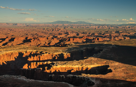 Outlook from the Island in the Sky area of Canyonlands National park at the Grand View Overlook at Sunset on a mid August summers Day. Stock fotó