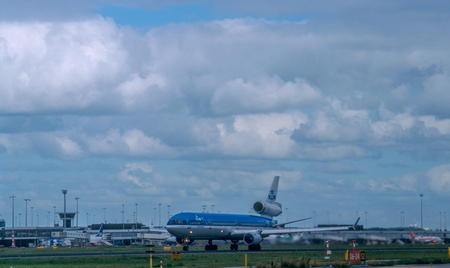 AMSTERDAM, NETHERLANDS, CIRCA SEPTEMBER 2001. An MD11 Passenger aircraft operated by KLM taking off from Schiphol airport . KLM was the last airline to operate an MD11 for passenger flights.
