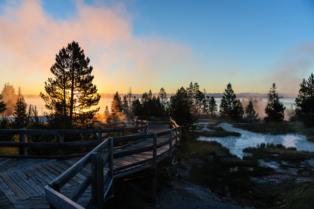 A sunrise in the West Thumb Area in Yellowstone National Park, illuminating the boardwalks.