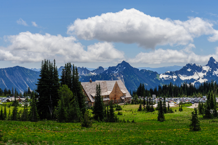 Overview of the Sunrise visitor center and parking area on Mount Rainier, on a summer afternoon.