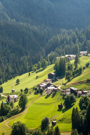 Impression of a rural Village in the rugged Alpine Mountains in the Italian Dolomites on a beatiful Summer's Afternoon.