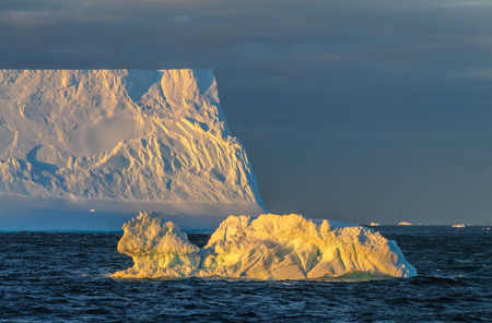 Antarctic Sunset: Floating Icebergs in the Weddell Sea, near the Antarctic Peninsula, as seen from an Antarctic Exploration Ship