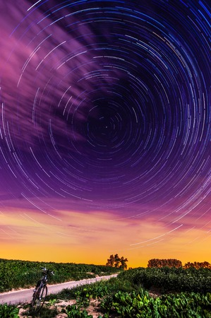 A star trail seen from the flemish country side, near the Belgian city of Geraardsbergen.