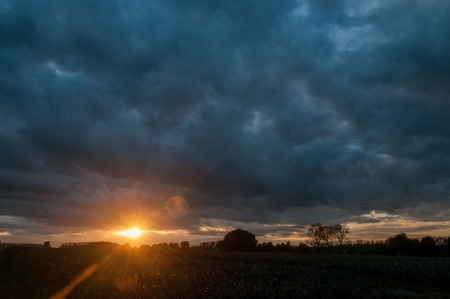 An early evening sunset in east flanders, belgium Stock Photo