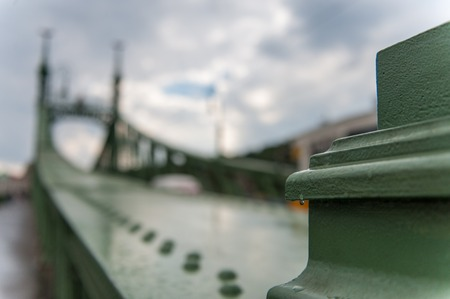 Closeup of a raindrop hanging on Budapests famous bridge