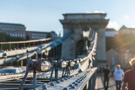 Imperssion of the Széchenyi Chain Bridge in central budapest with out of focus pedestrians passing by.