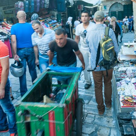 Jerusalem, Israel. June 6, 2013. An impression of the busy merchants near Damascus gate. Time exposed to convey motion and urgency.