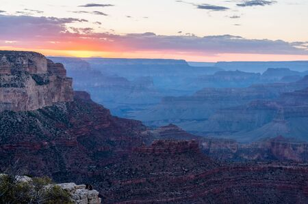 The setting sun sinking below the horizon of the Grand Canyon, near Yavapai point on the southern canyon rim.