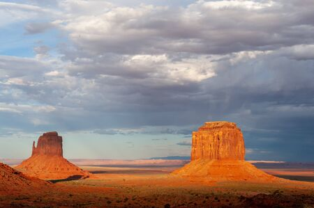 The famous Merrick and Mittens Buttes from monument valley basking in the Light of the setting sun.